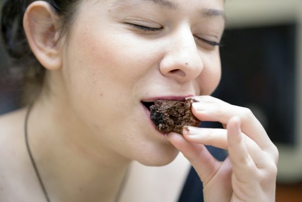 Happy woman eating brownie